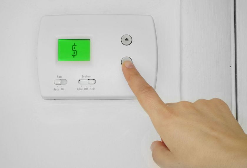 Someone Pressing Thermostat Button