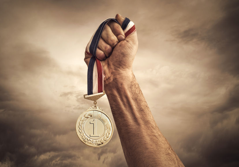 Hand Holds a First Place Medal for World-Class Home Maintenance