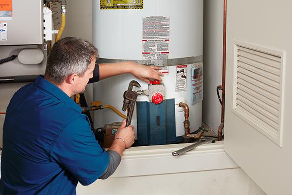 Maintenance Man Fixes Water Heater