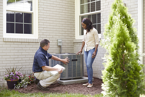 Man standing in front of an AC unit