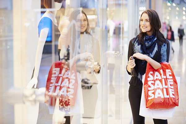 Woman shopping with sales bags