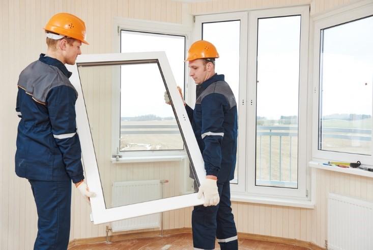 Contractors installing windows