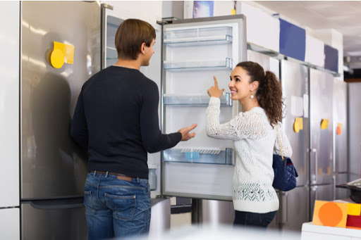 Couple looking at buying a new refrigerator