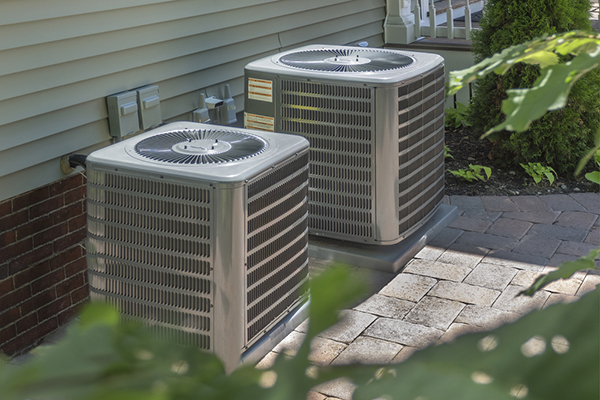 Two HVAC units outside residential