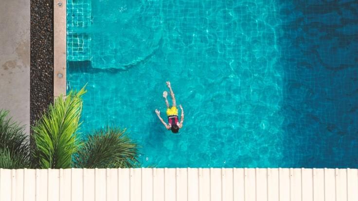 Homeowner enjoying pool