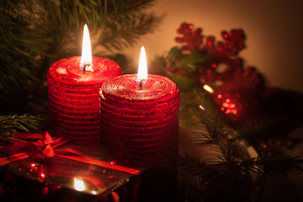 Holiday candles with exposed flame