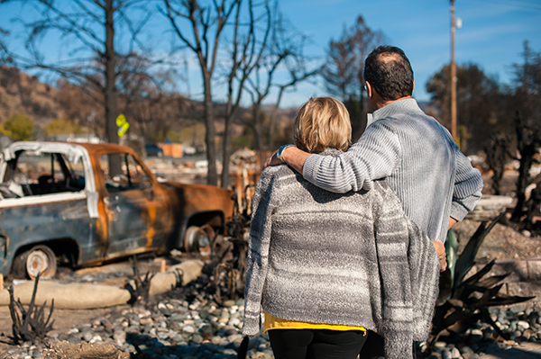 Couple looking at ruins from wildfire