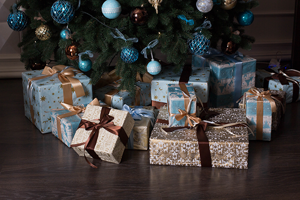 Gold and blue wrapped gifts under tree