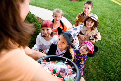 Children getting candy for halloween
