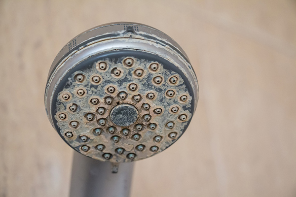 Hard water on shower tap
