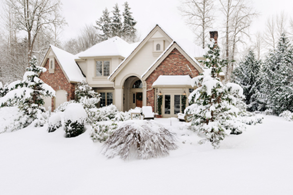 Home covered in snow