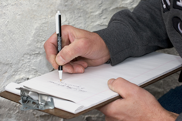 Home inspector making notes during an inspection