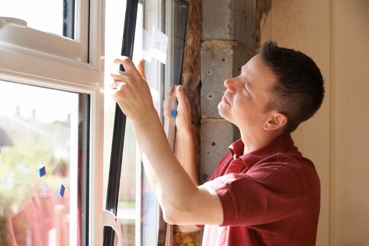Homeowner looking at home window