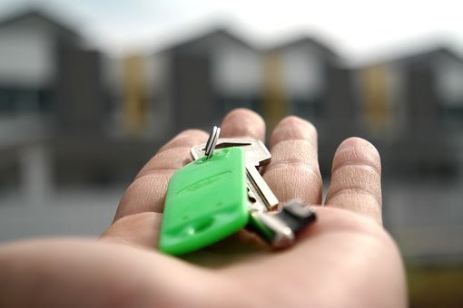 Homeowners with new keys to home