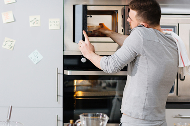 Man opens microwave