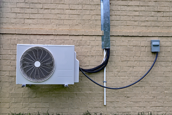 Mini split hvac mounted to brick wall