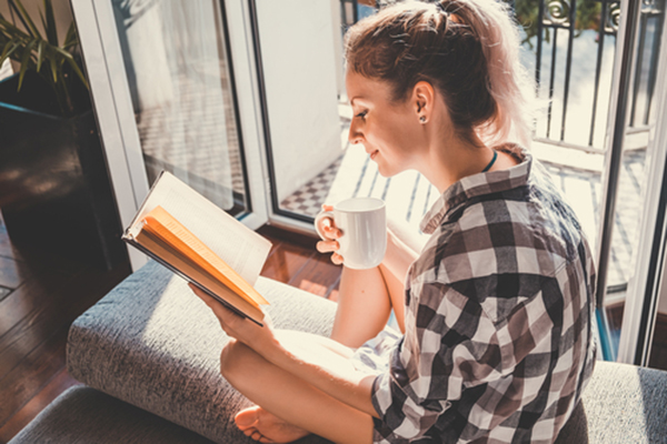 Woman reads book with natural light