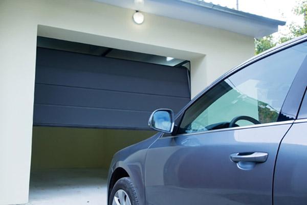 Car in front of opening garage door