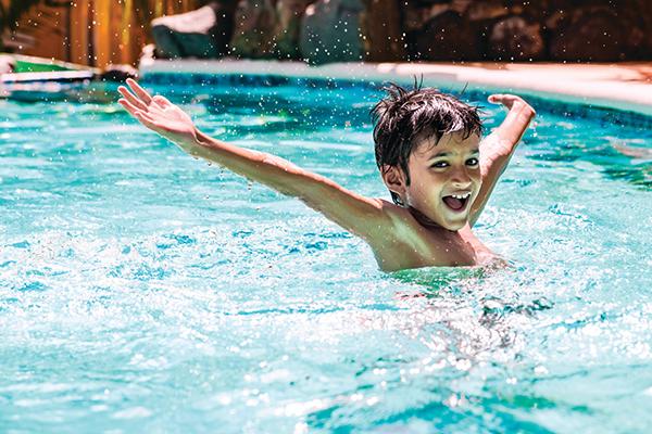 Boy enjoying pool safety