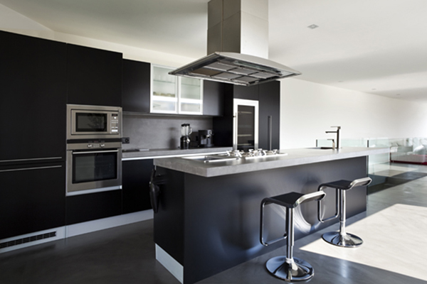 Range hood in black kitchen