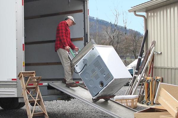 Man getting rid of appliance