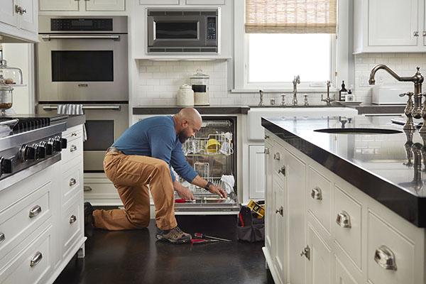 Repair to dishwasher in kitchen