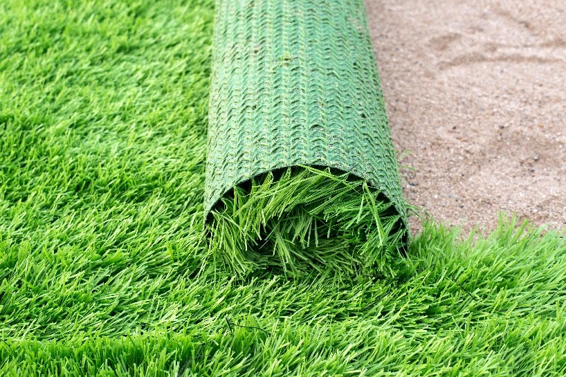 Laying down artificial turf