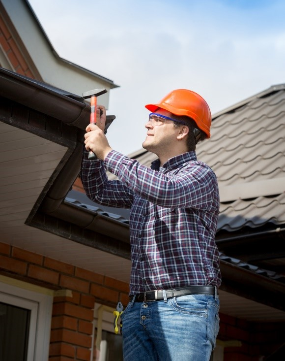 Homeowner conducting roof inspection