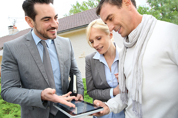 Real estate professional helping with clients