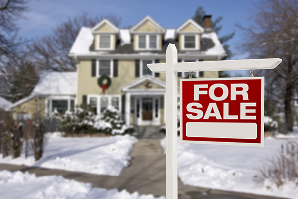 snowy home for sale sign