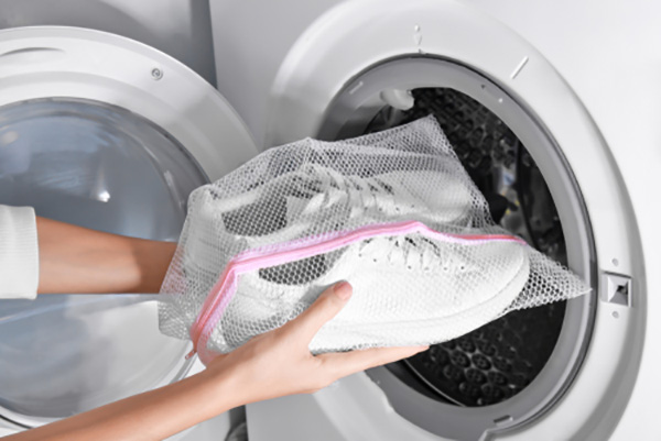 Shoes in mesh bag going in washer