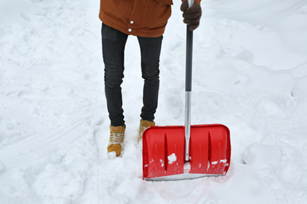 Shoveling snow in driveway