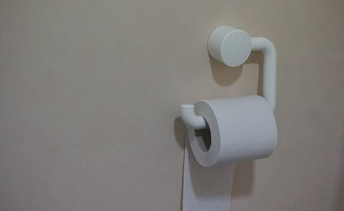 Toilet paper hanging on the wall