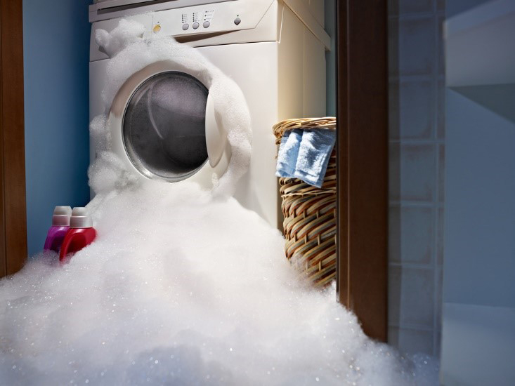 Washing machine overflowing with soap