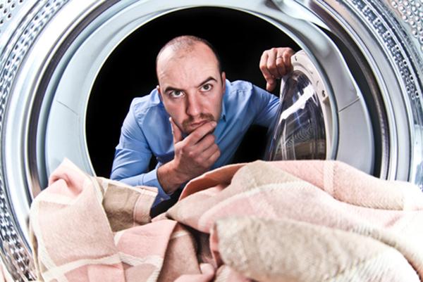 Man looking into the washing machine