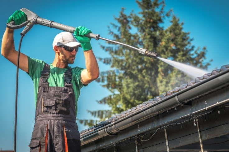 Washing the gutters and roof