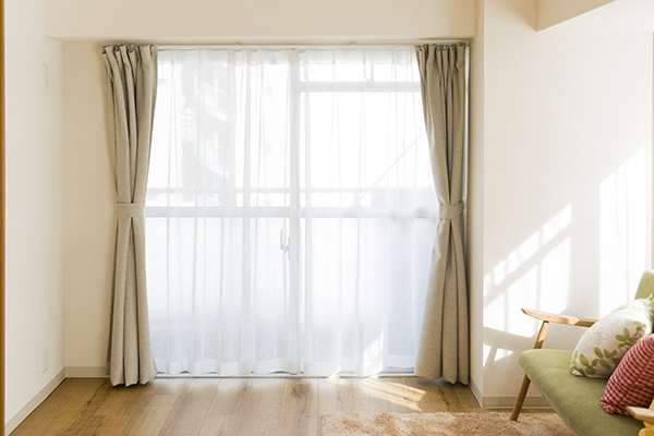 Window treatment in a living room with a big window