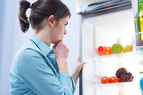 Woman looking into freezer