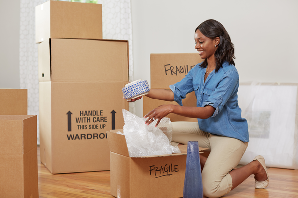 Woman unpacking in new home