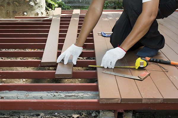 Someone Installing a Wooden Deck in Home