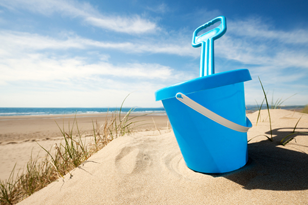 Blue Beach Pail and Shovel on a Beach During a Summer Vacation