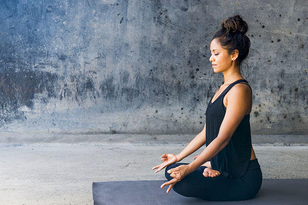 Woman in seated yoga position