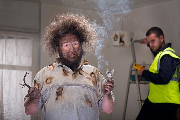 Man with Burnt Hair and Clothes After a Fuse Caught on Fire