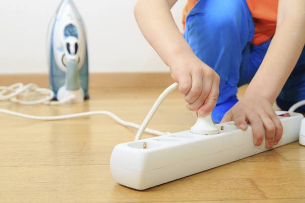Child Connects an Iron to a Surge Protector - Common Electrical Hazard