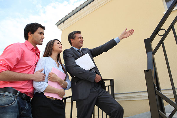 Real Estate Agent Showing a Home to First-Time Buyers