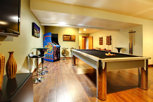 Game room with pool table and arcade
