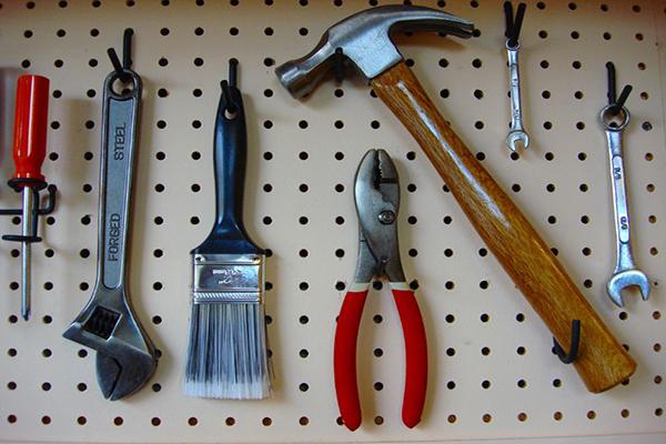 Tools hanging on garage pegboard