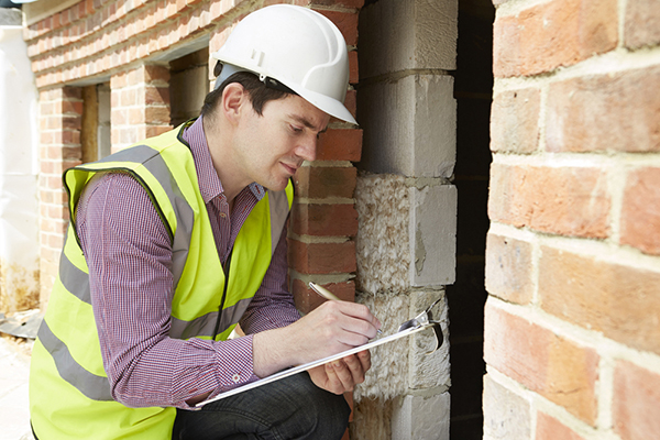 American Home Shield Inspector Inspecting a Building