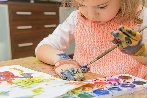 Child making mess on table