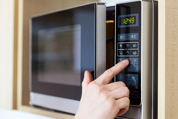 Someone Pressing Microwave Buttons